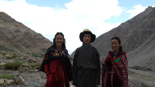 young man and women posing in front of mountains - indigenous culture stock videos & royalty-free footage