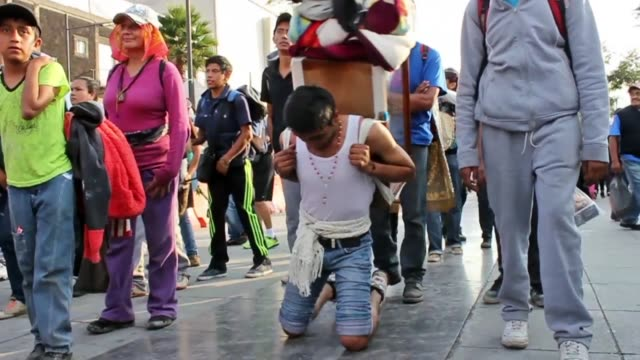 Young man approaches the Basilica of Guadalupe prostrate on his knees