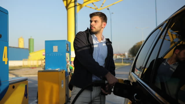 young man at gas station - fuel pump stock videos & royalty-free footage