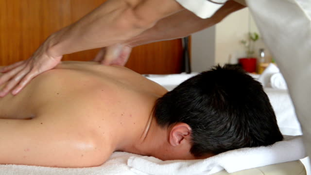 young man at spa treatment - massaging stock videos & royalty-free footage