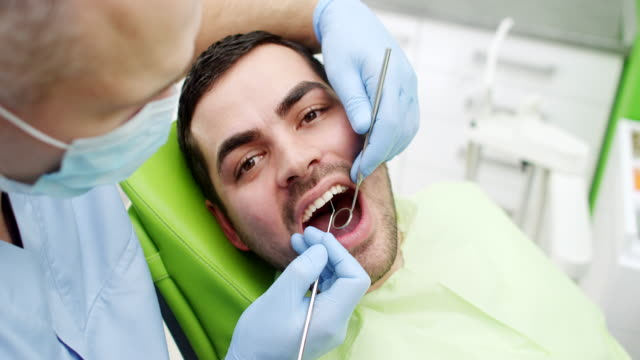 young man at the dentist - tooth care stock videos and b-roll footage