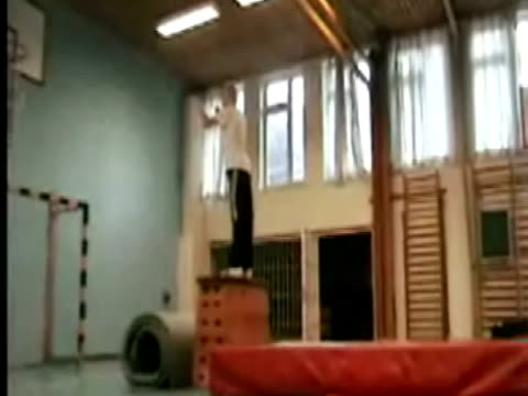 / young man attempts to do backflip in gym but ends up hitting his chin on the platform Backflip failure on June 14 2007 in Sweden