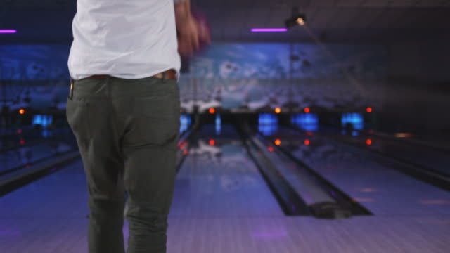young man bowling at a bowling alley - bowling alley stock videos & royalty-free footage