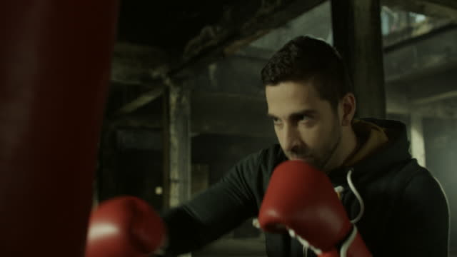 young man boxing workout - kickboxing stock videos & royalty-free footage