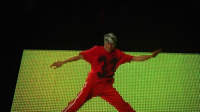 WS PAN TU TD SLO MO Young man break dancing in nightclub / London, UK