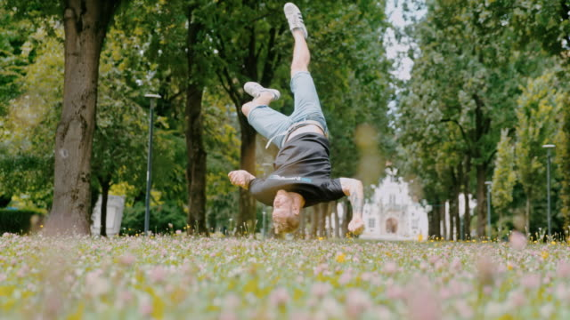ms young man breakdancing in park - exhilaration stock videos & royalty-free footage