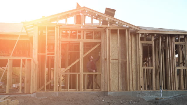 ws young man building his dream house - holz stock-videos und b-roll-filmmaterial