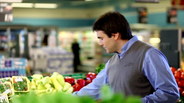 young man buying red pepper - red bell pepper stock videos & royalty-free footage