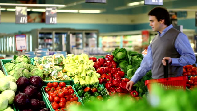 young man buying vegetable - choosing stock videos and b-roll footage