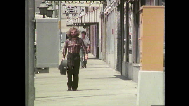 young man carries guitar case on street in nashville; 1979 - 1970 1979 stock videos & royalty-free footage