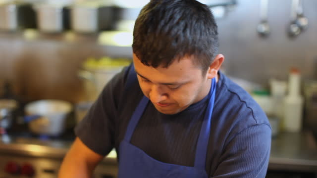 cu td tu young man chopping parsley in restaurant kitchen, portland, maine, usa - parsley stock videos and b-roll footage