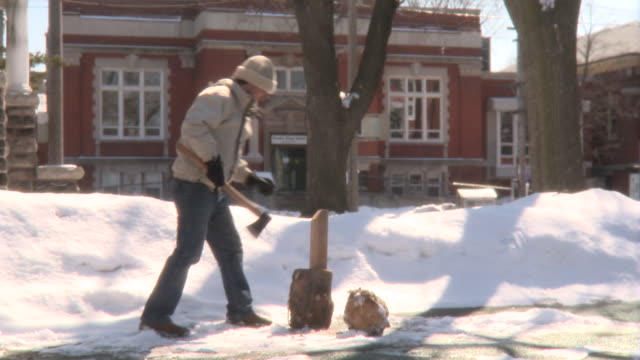 ms young man chopping piece of wood in half and tosses in winter day/ toronto, ontario, canada  - firewood stock videos and b-roll footage