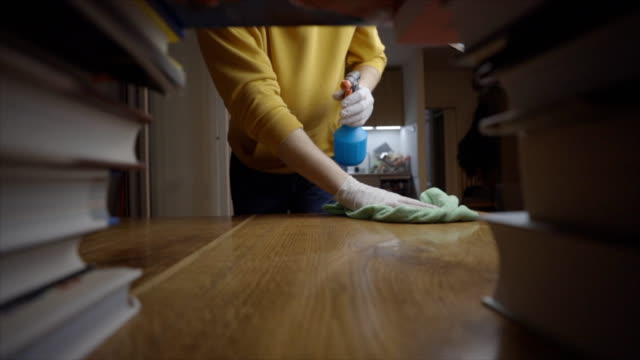 young man cleaning table with disinfection spray - stack stock videos & royalty-free footage