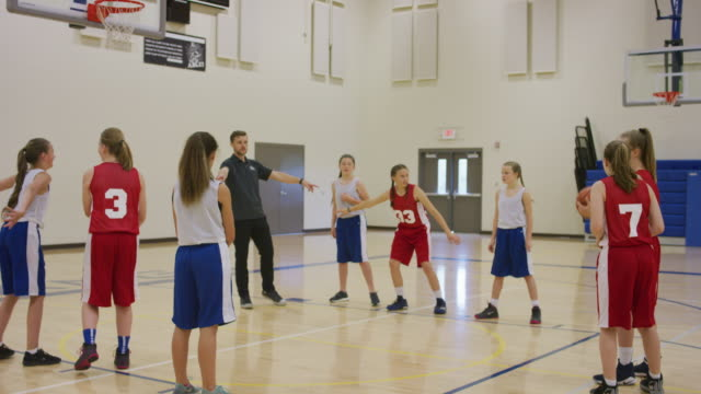 young man coaching girls basketball team - secondary school child stock videos and b-roll footage