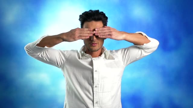 young man covering eyes with his hands - blindfold stock videos & royalty-free footage