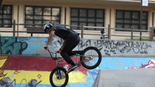 a young man crashes on his bmx bicycle. - slow motion - failure stock videos & royalty-free footage