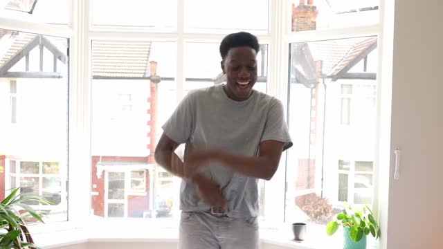 young man dancing in house - adult stock videos & royalty-free footage