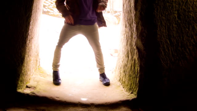 young man dancing in the cave doorway - doorway stock videos & royalty-free footage