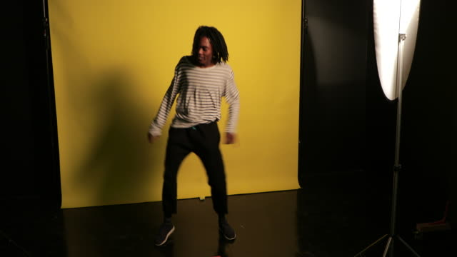 Young Man Dancing in the Studio