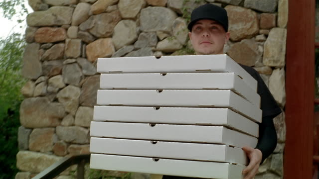 young man delivering stack of pizza boxes - stack stock videos & royalty-free footage