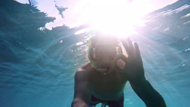 POV Young man diving in sunshine