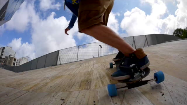 a young man does a jumping trick on a skateboard. - longboarding stock videos & royalty-free footage