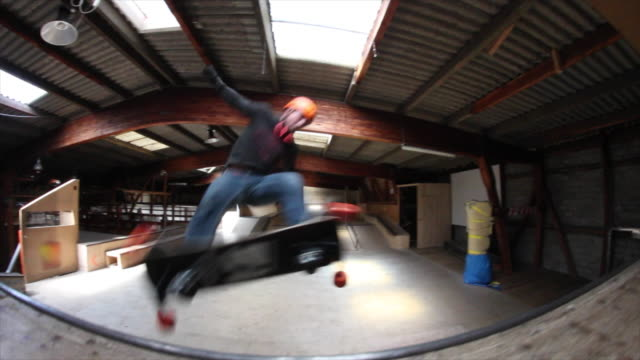 a young man does a trick on a skateboard on a ramp. - sports ramp stock videos and b-roll footage