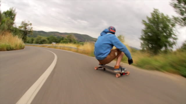 a young man does some tricks on a skateboard while riding down a hill. - time-lapse - haltung stock-videos und b-roll-filmmaterial