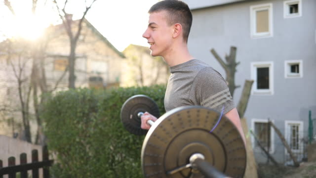 young man doing bench press exercise - bench press stock videos & royalty-free footage