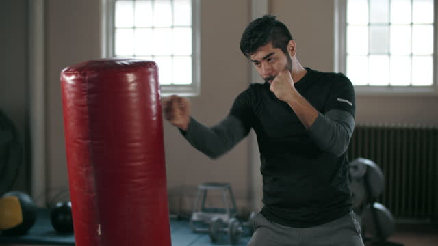 young man doing mixed martial arts - only men stock videos & royalty-free footage