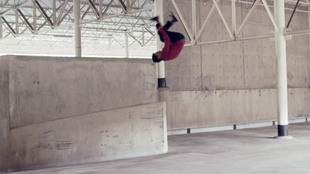 young man doing parkour tricks in a building - agility stock videos & royalty-free footage
