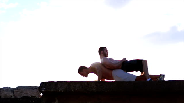 young man doing push ups - male friendship stock videos and b-roll footage