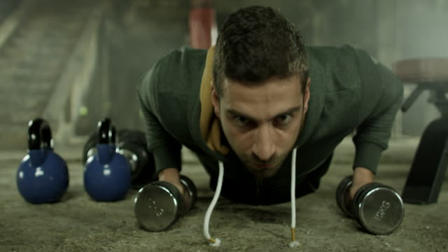 young man doing push ups - strength training stock videos & royalty-free footage