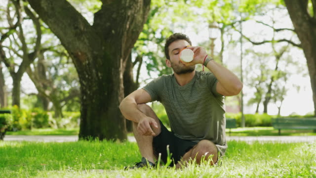 young man doing push-ups and drinking protein shake - protein drink stock videos & royalty-free footage