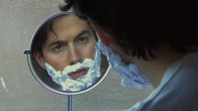 CU Young man doing shaving / Hackney, United Kingdom