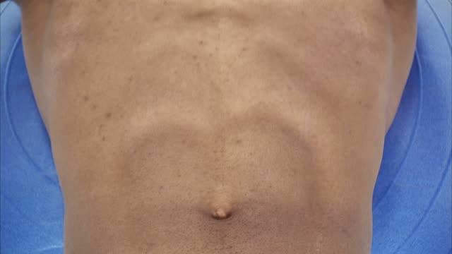 cu young man doing sit ups, close up of abdomen / orem, utah, usa - menschlicher muskel stock-videos und b-roll-filmmaterial