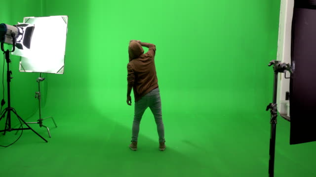 young man drawing graffiti on green screen studio - artist stock videos & royalty-free footage
