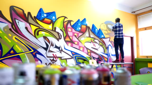 young man drawing graffiti - aerosol can stock videos & royalty-free footage