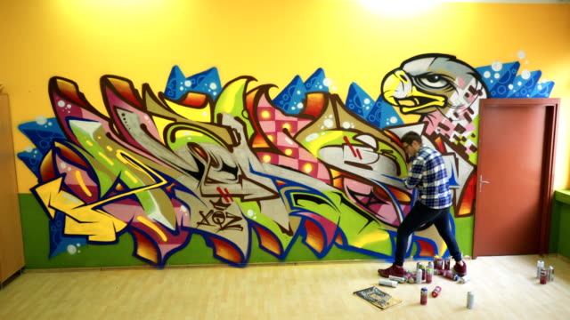 young man drawing graffiti - spray painting stock videos & royalty-free footage
