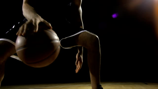 young man dribbling a basketball - basketball sport stock videos & royalty-free footage