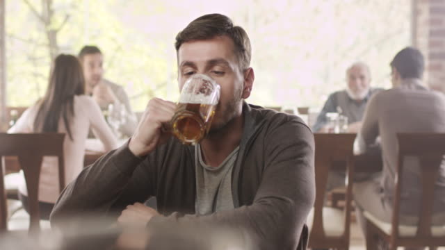 young man drinking beer - temptation stock videos & royalty-free footage