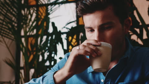 young man drinking tea at cafe - button down shirt stock videos & royalty-free footage