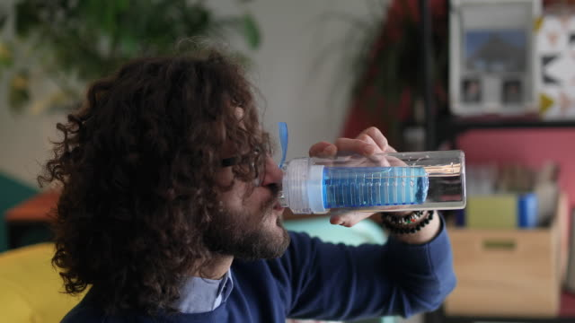 young man drinking water from reusable bottle - reusable stock videos & royalty-free footage