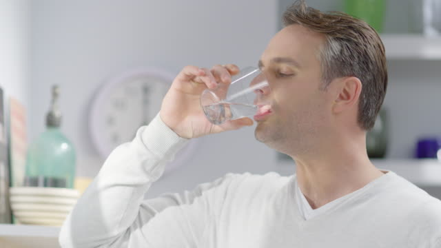 young man drinking water - drinking stock videos & royalty-free footage