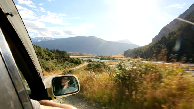 young man drives down 4x4 road admiring mountain view along the way - weekend activities stock videos and b-roll footage