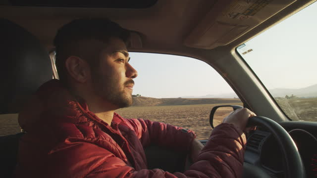 cu young man driving a car on a rural road - sports utility vehicle stock videos & royalty-free footage