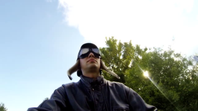 hd: young man driving moped - helmet motorcycle stock videos and b-roll footage
