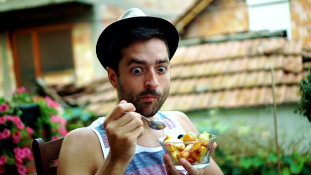 young man eating fruit salad - fruit salad stock videos & royalty-free footage