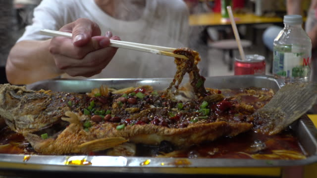 young man eating the street food at singapore - singapore stock videos & royalty-free footage