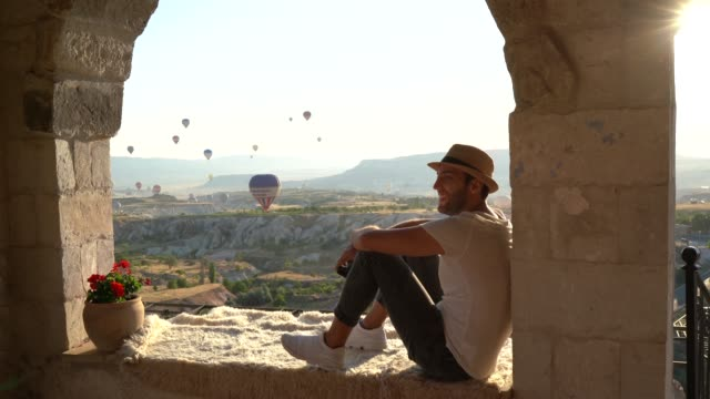 young man enjoying a incredible view during ballooning festival - only men stock videos & royalty-free footage